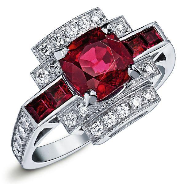 ANEOR : Bague en or blanc sertie d'un rubis rond au centre, deux rubis taille princesse de chaque cotés et un escalier serti de diamants #bague #orblanc #diamants #bijoux #luxe #valeriedanenberg  #rubis