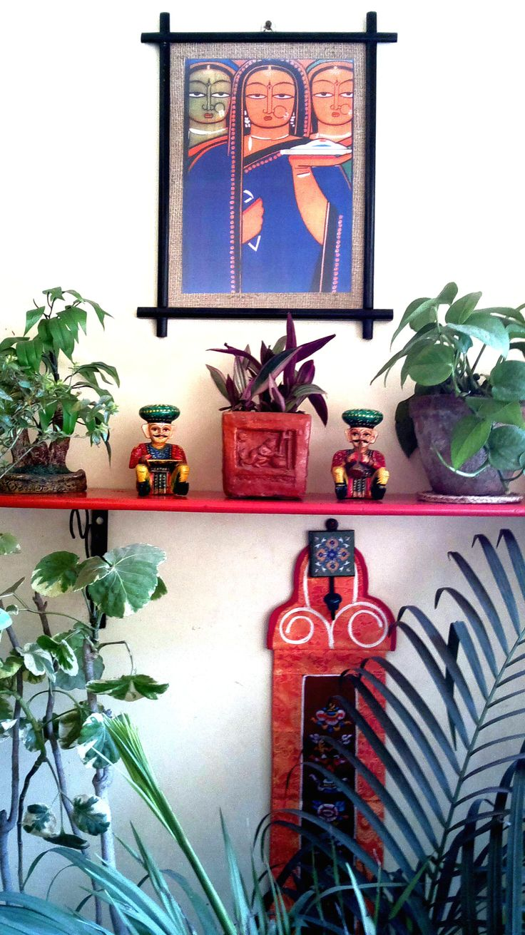 my balcony decorated in Indian flavour....terracotta pots, Jamini Roy painting, Buddhist scroll and lots of greenery.........of course ! :)
