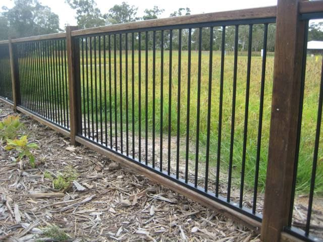 Developer Fence with 100mm Base Aluminium Panels Hardwood Posts with top and bottom Rail