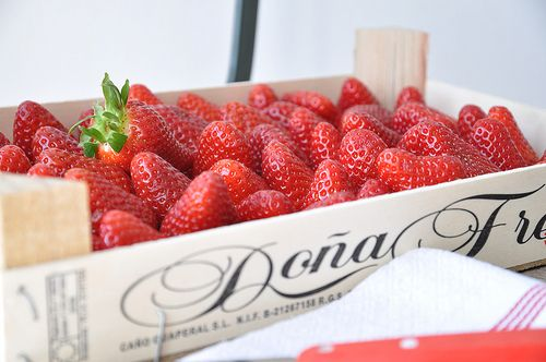 Crate of fresh red strawberries. Summer.