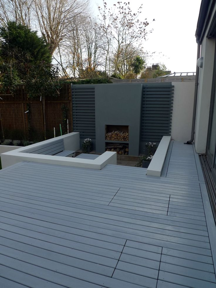 modern minimalist garden design low maintenance high impact garden design raised white wall beds grey decking east grass lawn turf sunken garden with fire and chimney flat trees balham wandsworth london (10)