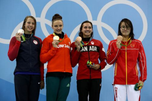 (L-R) Silver medalist Kathleen Baker of the United States, gold medal medallist Katinka Hosszu of Hungary and bronze medalist's Kylie Masse of Canada and Yuanhui Fu of China pose on the podium during the medal ceremony for the Women's 100m Backstroke...