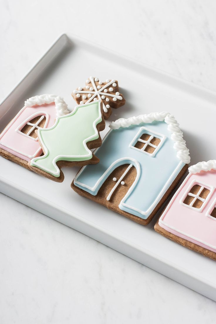 Make these adorable gingerbread house cookies using basic royal icing decorating techniques. Inspired by Peggy Porschen's pastel gingerbread house cake.