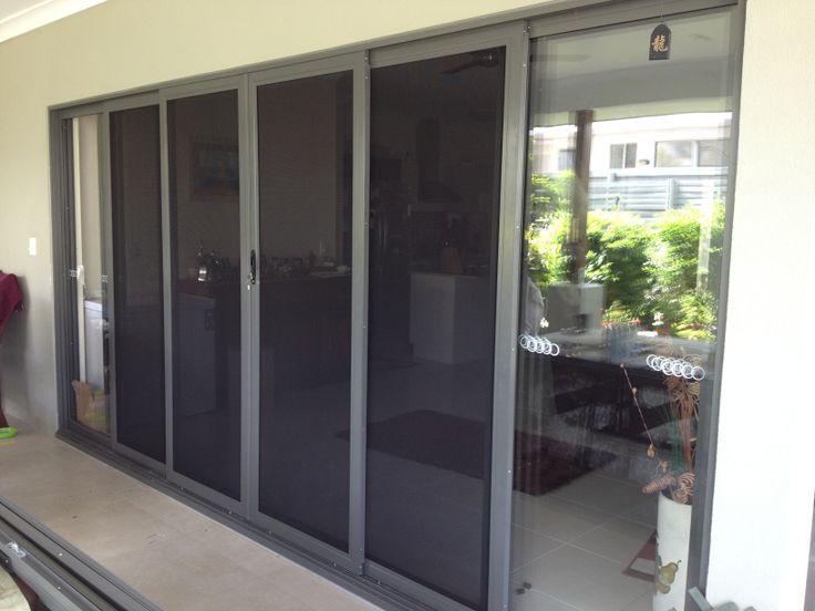 Stainless steel stacker sliding doors. Custom powder coated to suit existing colour scheme