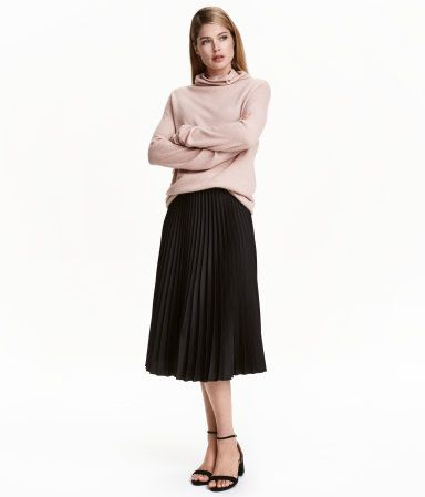 Black. Knee-length circle skirt in pleated fabric with a concealed zip and button at side.