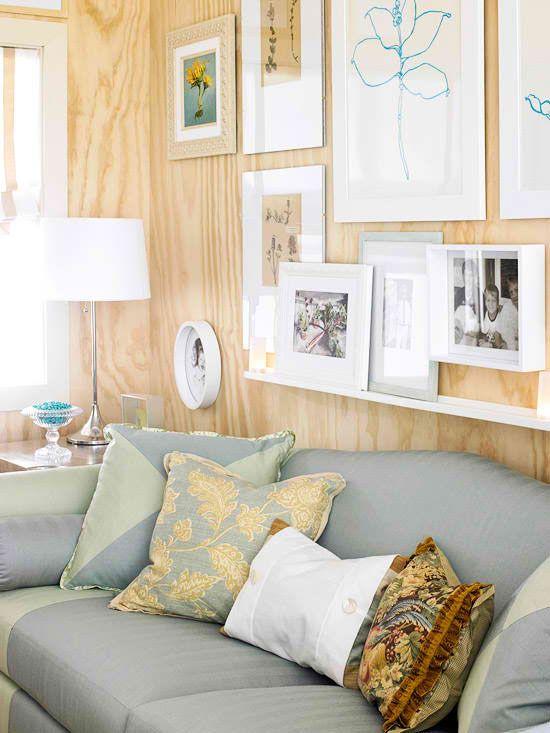 Plywood walls with art display