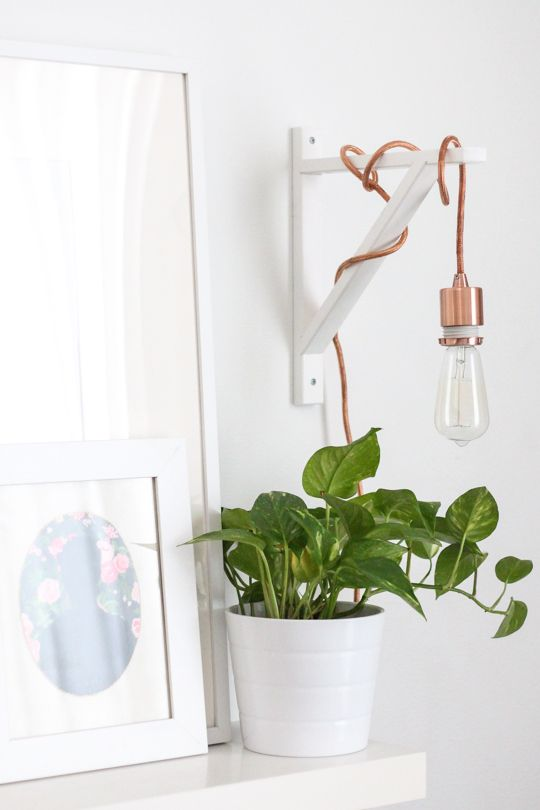 DIY metallic wall sconce for bedroom. white bracket with rose gold/copper chord