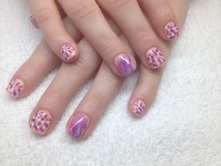 Gel nails - pastel orange with purple polka dots and swept colours