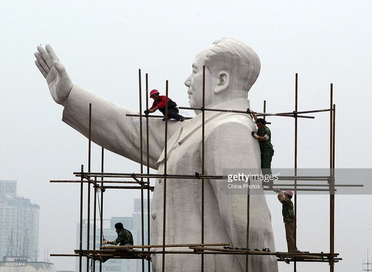 Workers build a scaffold to clean the statue of former Chinese leader Mao Zedong to prepare for the upcoming National Day Holiday September 21, 2008 in Chengdu of Sichuan Province, China. This year's National Day Holiday will run from September 29 to October 5.