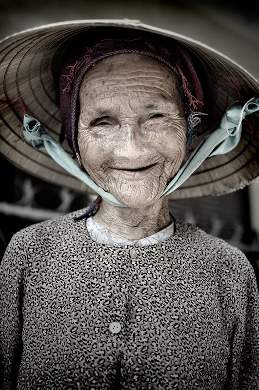 """""""One of the happy residents of Hoi An out for a morning at the market. Nice enough to let me take a picture and quite the character too. Although it seems everything in Hoi An had """"character"""". """" // Copyright: John Paskey (happypoppeye)"""