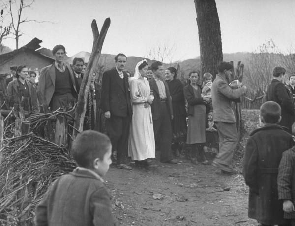 Civil War/Greece  The bride following the lute player marching up muddy wood to the church.Location:Louzesti, Greece  Date taken:1947  Photographer:John Phillips