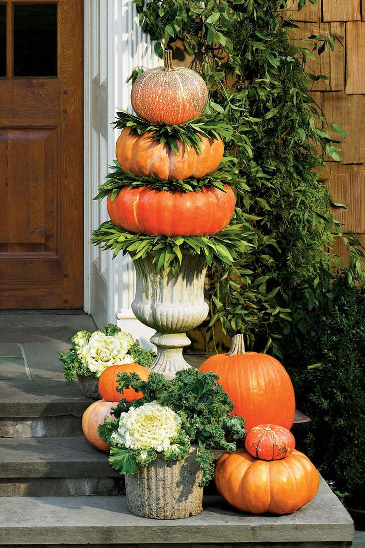 Stack Your Pumpkins | Add some autumnal curb appeal. Excited about fall? Can't wait to outfit your home in seasonal decor? We're with you. Peruse our ideas for outdoor fall decorations, and celebrate the season as soon as possible. When the weather turns cool, it's time to deck your home in these one-of-a-kind seasonal ideas, decorations, plants, and crafts. Add a few special touches and outside fall decorations to your home, yard, and front door this season, and you'll be the envy of the