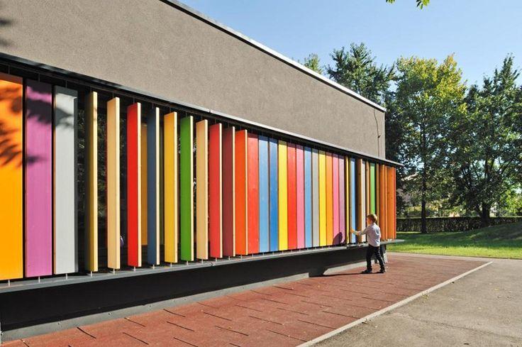 Colorful interactive design enables children to play with & change their kindergarten's exterior wall. Kindergarten Kekec by Jure Kotnik Architecture