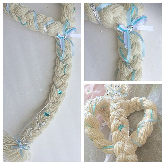 Inspired by the Disney movie Frozen. Great for all ages. A yarn braid accessorized with sparkly ribbons and rhinestones. Perfect for your little