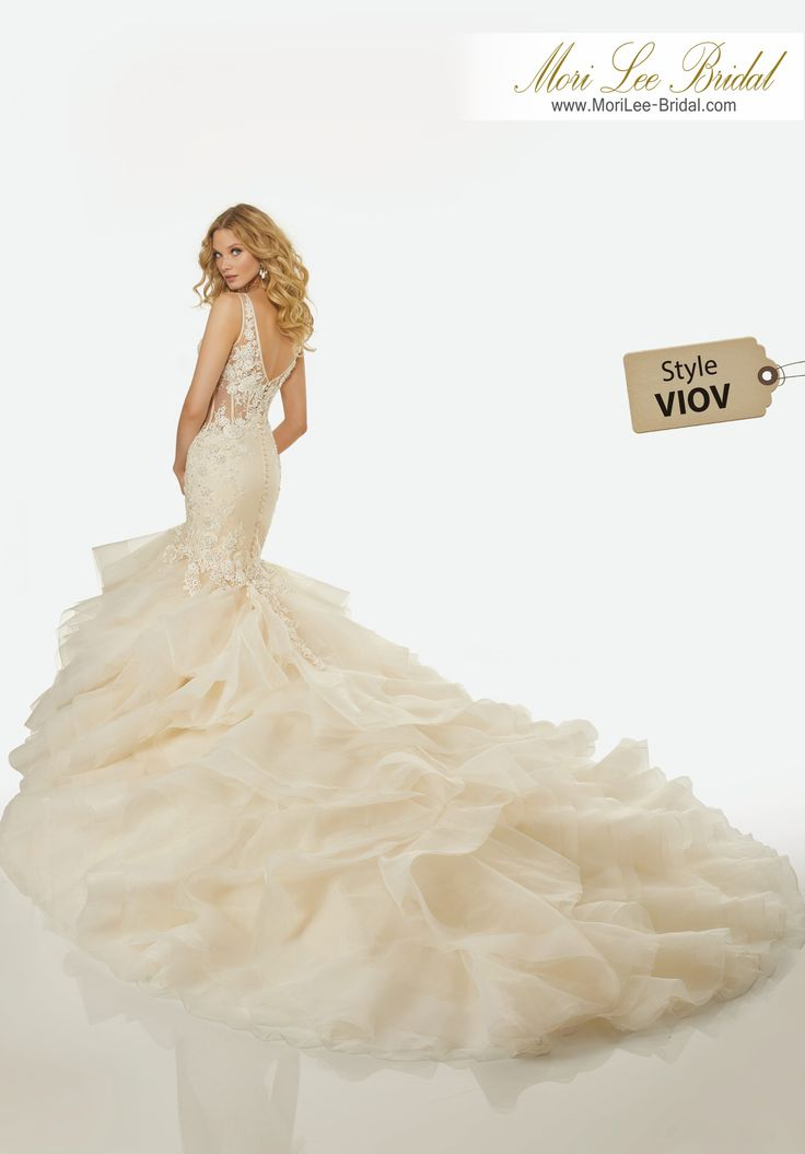 Style VIOV CHARLIZE WEDDING DRESS Crystal Beaded, Floral Appliqués and Lace on a V-Neck, Illusion Bodice with Horsehair Edged, Flounced Tulle and Organza Mermaid.Colors:IVORY, IVORY/LIGHT GOLD