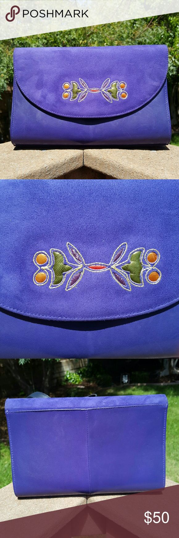Vintage Purple Clutch / Purse Gorgeous deep purple clutch / purse with appliqu?. Strap is easily able to be tucked away into purse so you can use it as a clutch. Leather strap is adjustable and is long enough to make into a cross body purse. Has a zippered pocket inside of purse and has snap closure. Top part of flap on clutch with design is suede and the rest of clutch is leather. Made in Spain. Vintage item from the 1980s. In excellent condition.   Measurements are  Length - 10 inches…
