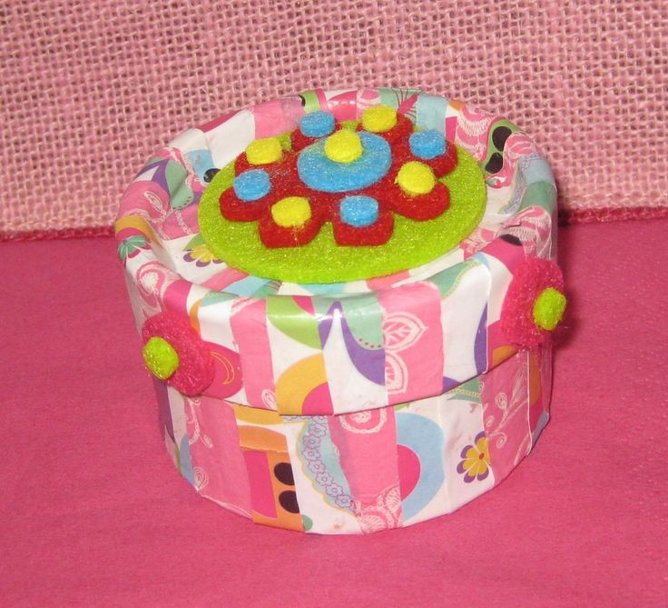 Trinket box decorated with recycled wrapping paper.