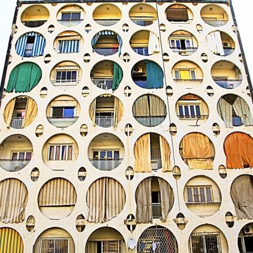 Beirut building with circular openings in modern architecture built environments installation architecture|