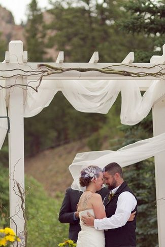 DIY Colorado Rocky Mountain Ranch Rustic Wedding | Confetti Daydreams - White wooded wedding arch  - with curly willow and sheer fabric