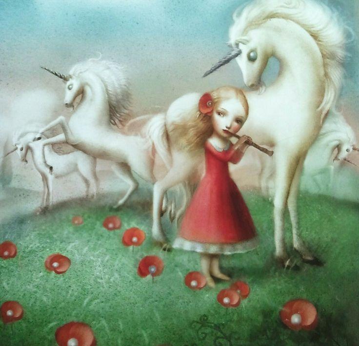 Nicoletta Ceccoli: image of girl in red dress charming unicorns