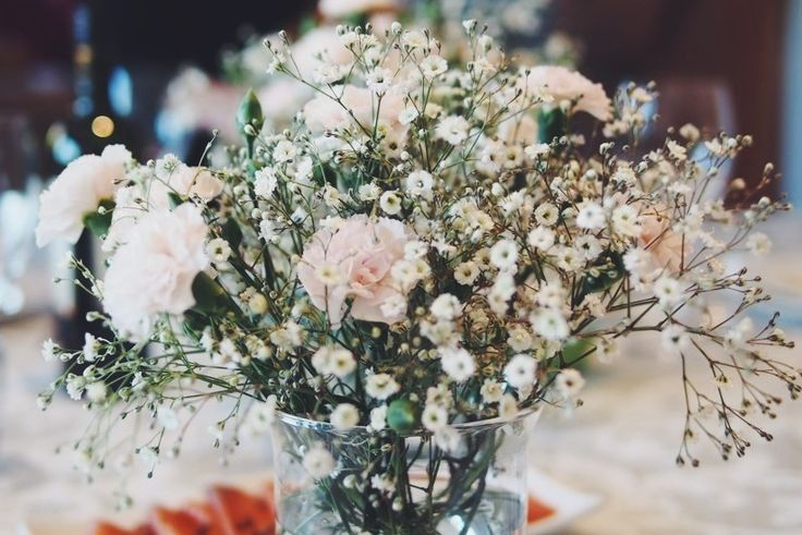 Photo by Jessica Totino- Love me some gyp. Flowers are the perfect accessory for any table setting.