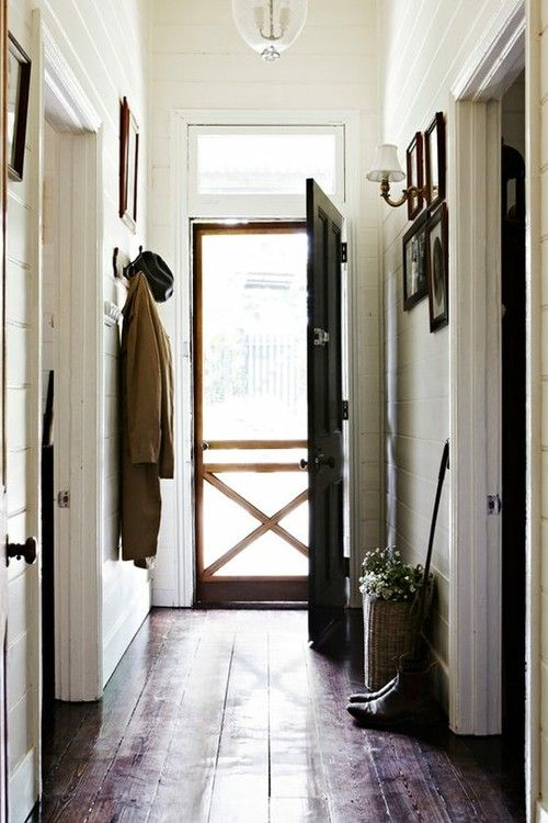 black door / white wall / wide floorboards