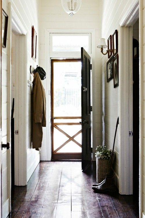 black door / white wall / wide floorboards