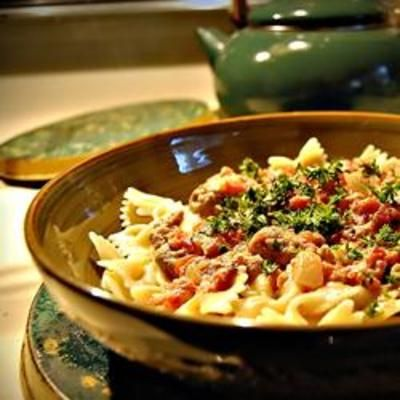 Bow Ties with Sausage, Tomatoes and Cream: Bows Ties Pasta, Plum Tomatoes, Rich Sauces, Bow Ties, Italian Sausages, Sweet Italian, Bowties, Heavy Cream, Bow Tie Pasta
