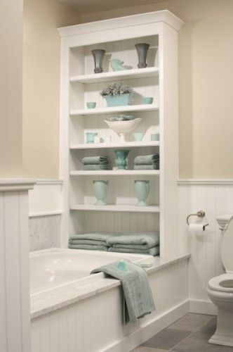 Bathroom shelving behind bathtub