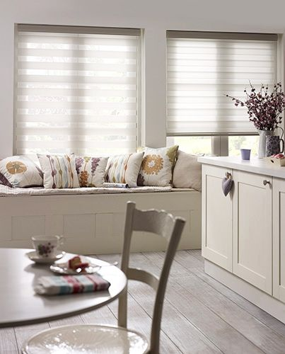Enjoy Vision White roller blind - make the most of the sunlight while maintaining your privacy with this exquisite roller blind. A double layer of light fabric with alternating sheer strips allows you to control just how much light you allow in. #blinds #roller #voile