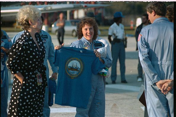 Cape Canaveral Florida School teacher astronaut Christa McAuliffe displays a Tshirt with the seal of the state of New Hampshire printed on the front...
