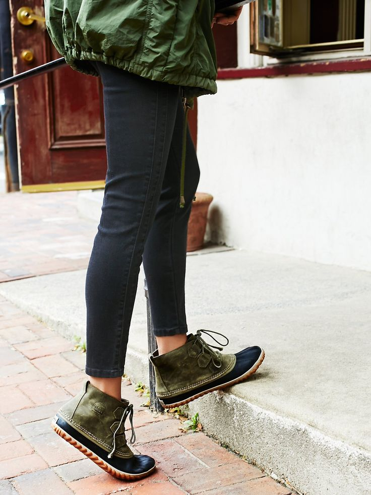 Out N About Weather Boot | Don't let the bad weather cramp your style, these good-looking weather boots are cute and waterproof. Handcrafted with an adjustable bungee lace-up and durable textured soles made from natural rubber. *By Sorel