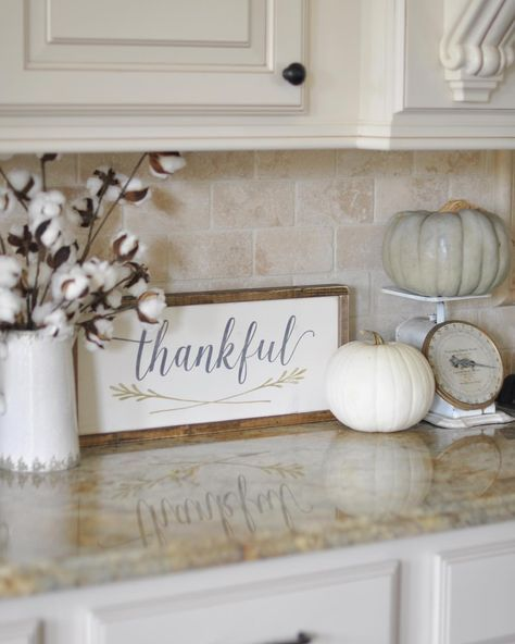 "This week the ladies hosting #OurGratefulHome want to see our #fallkitchen decor. I received this precious ""Thankful"" sign in the mail yesterday from /charlie/.and.ella, so I had to use it right away. It ended up on my kitchen counter with my vintage scale, a couple of pumpkins, and my cotton stems from /paintedfox1/, and I love it! Yay for happy mail!"