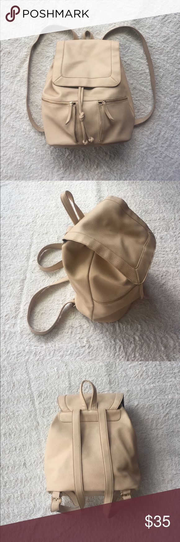 Cream Backpack Super cute - cream colored backpack. Has adjustable drawstring and magnetic top closure. Top handle - adjustable shoulder straps. Two front, functional zippers. Zippers are gold. One large zipper closure pocket on inside. Has some small marks from light use - all shown in photos. A great everyday bag! Bags