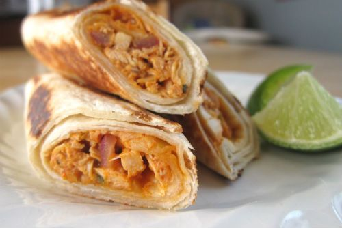 An easy to prepare, light, and tasty Mexican dish, these Chicken, Salsa and Cheese Flautas work well as either an appetizer or a meal.