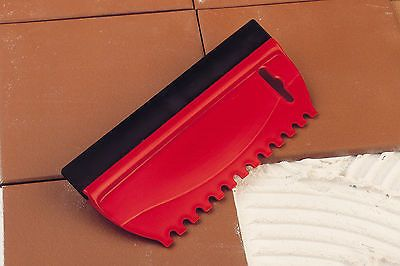 UK made wall tile adhesive spreader grouter tool. It has a serrated edge for spreading tile adhesive and a rubber blade for grouting. (S7196)