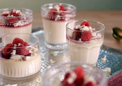 White Chocolate Panna Cotta Recipe Here: http://www.asianfoodchannel.com/shows/simply-laura/recipes/white-chocolate-panna-cotta-with-raspberry-sauce