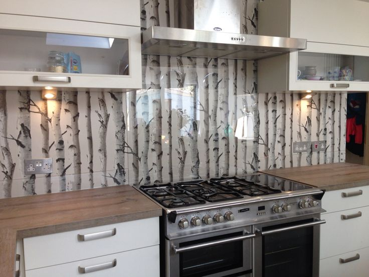 Clear glass splashback with great effect wallpaper behind for Wallpapered kitchen ideas
