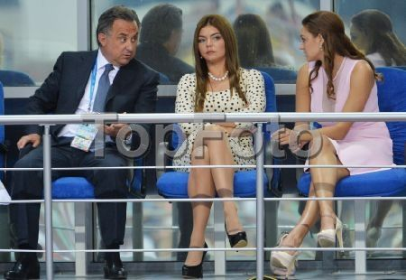 2246312 Russia, Kazan. 07/16/2013 From left: Russian Sports Minister Vitaly Mutko, member of RF Duma Committee for Physical Education, Sports and Youth Affairs Alina Kabaeva, two-time Olympic rythmic gymnastics champion (2008 and 2012) Evgenia Kanaeva during the rhythmic gymnastics competition at the 27th World University Summer Games in Kazan. Iliya Pitalev/RIA Novosti