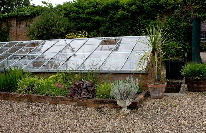 Read nearly everything you'd ever want to know about pit greenhouses and see multiple examples, here: