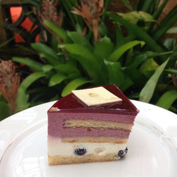 A slice of lychee blueberry cake dessert