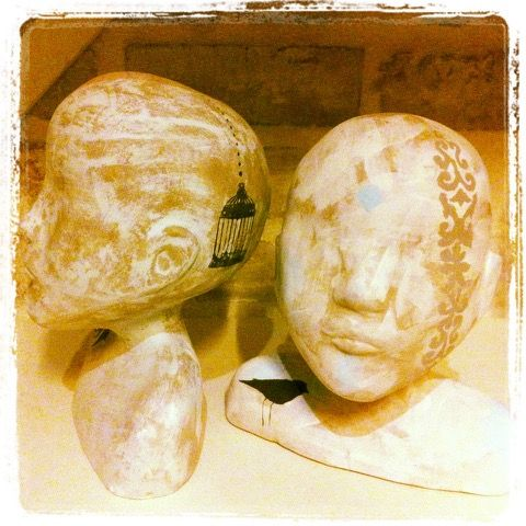 A plaster mould was casted from the proto-type which   I sculpted in clay.  A series of 8 heads were then slip casted.  Layered surface decoration was done in underglaze before the  heads were bisqued fired.