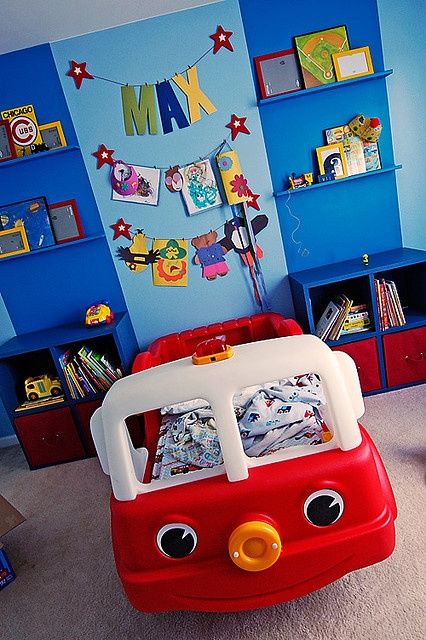 My boy's firetruck bed is gone now, but I still would like to hang pictures on a clothesline like this.