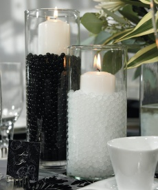 candles black and white - think short square holders with the black on the bottom, white candle on top