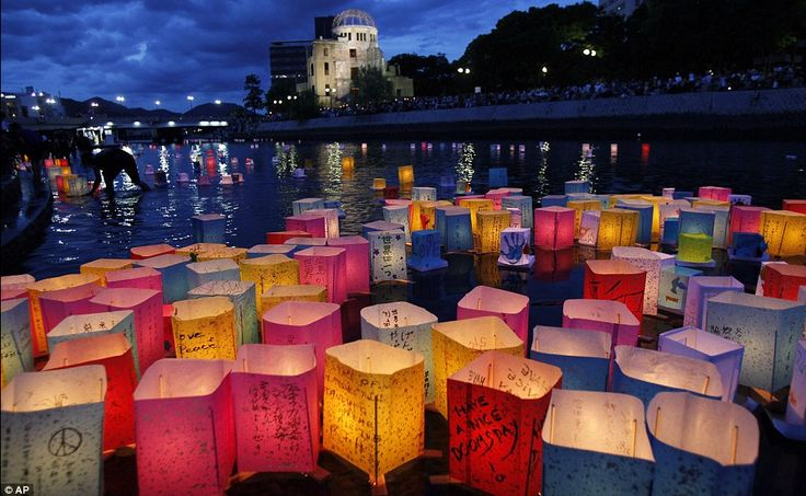 Paper lanterns float down the Motoyasu River in Hiroshima to mark the 66th anniversary of the bombing