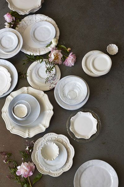 Incorporate an assortment of dishes for a visually exciting way to add texture and patterns to the table. Mix and match dish sets to get this look.Photo Credit: Jonny Valiant and Miki Duisperhof