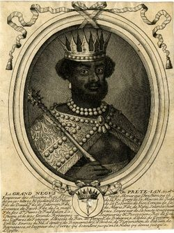 In addition to St. Maurice, there is also another figure connected to the blackamoor coat of arms. It is the semi-mythical Negus (emperor) of Ethiopia, Prester John. To Otto von Freising an Imperial Hohenstauffen Prince Bishop of the 12th century who was tired and torn by the endless struggle between Church and State, this black man who was both priest and king and ruled a land of peace and plenty at the edge of the world became the personification of the ideal state. To this day the arms of…