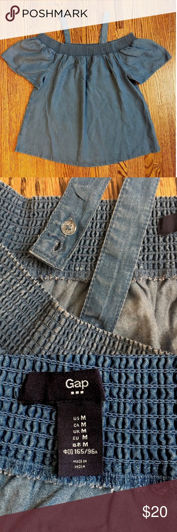 GAP Ladies Denim Blouse Super cute, light-weight denim top worn only once. Straps can be removed. Perfect to pair with white denim jeans or shorts. A very versatile staple to any spring/summer wardrobe! GAP Tops Blouses