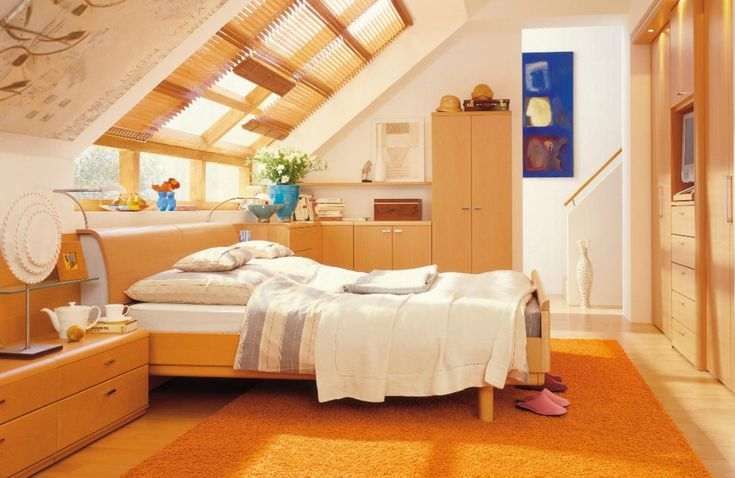 modern attic room ideas with beige furniture sets as well orange fur rug on wooden floor and bed underneath window