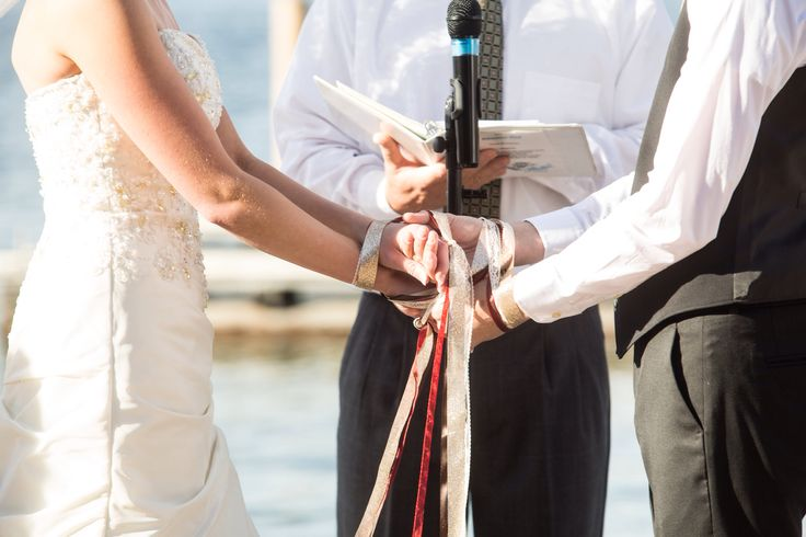 Hand fastening ceremony. Celtic wedding traditions. Ribbon ties. Fall weddings